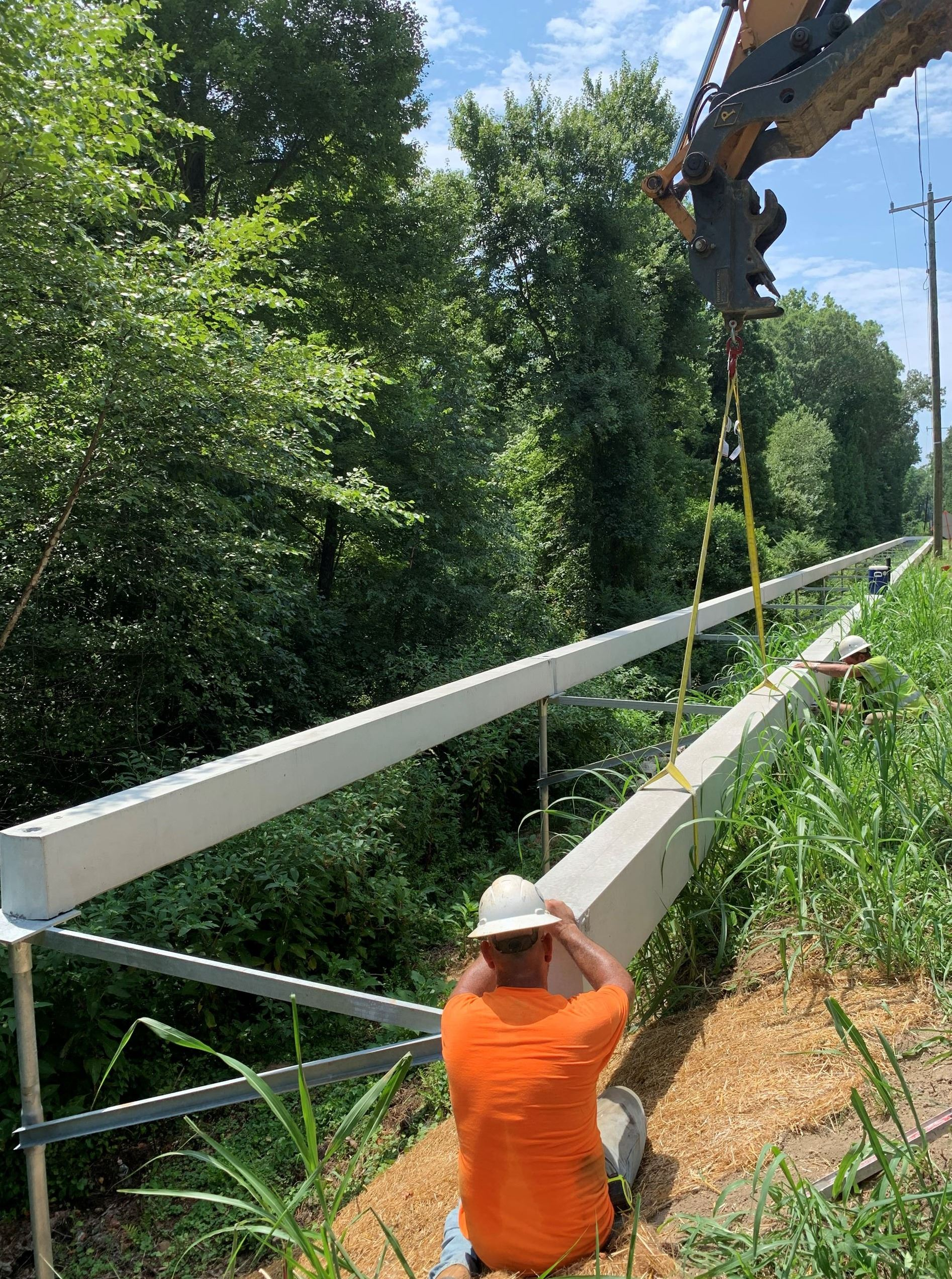 workers installing Trolley Line Trail boardwalk